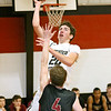 (Brad Davis/The Register-Herald) Greater Beckley Christian's Thad Jordan drives to the basket for a layup as Trinity's Josh Hart defends Saturday afternoon in Prosperity.