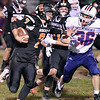 (Brad Davis/The Register-Herald) Summers County's Duke Dodson carries the ball Independence's Jordan Harvey moves in for the tackle Friday night in Hinton.