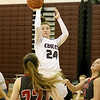 (Brad Davis/The Register-Herald) Woodrow Wilson's Liz Cadle puts up a short range shot before Cabell Midland's Autumn Lewis (#22) and Ryilee Allie, right, can get into position to defend Friday night in Beckley.