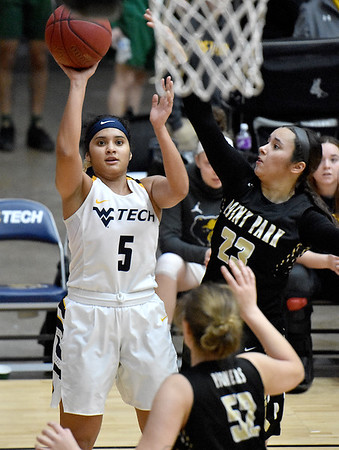 (Brad Davis/The Register-Herald) WVU Tech's Kathylee Pinnock Branford shoots as Point Park's Tyra James (#23) defends Saturday afternoon at the Beckley-Raleigh County Convention Center.