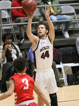 (Brad Davis/The Register-Herald) Woodrow Wilson's Danny Bickey shoots from three-point range as Parkersburg's Braeden Mason defends Friday night at the Beckley-Raleigh County Convention Center.