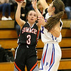 (Brad Davis/The Register-Herald) Summers County's Riley Richmond drives to the basket as Midland Trail's Jolee Stephenson defends Wednesday night in Hico.