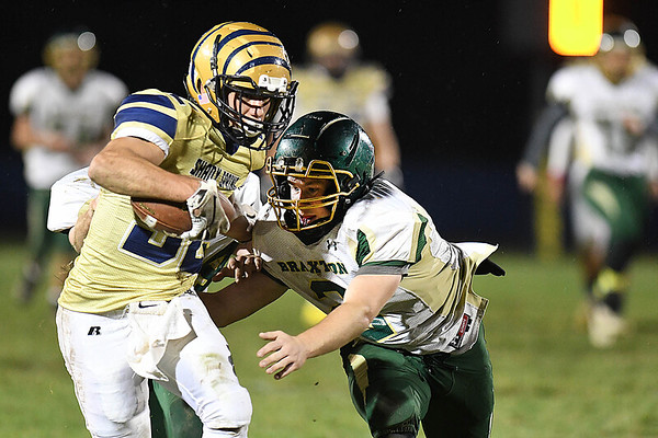 Jadon Hershberger, of Shady Spring, left, breaks away from, Drew Pitt, of Braxton Co. during game at Shady Spring High School.<br /> (Rick Barbero/The Register-Herald)