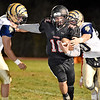 (Brad Davis/The Register-Herald) Liberty quarterback Ian Sloan cuts between Shady Spring defenders Haven Chapman, left, and Issac Harvey as he carries the ball Friday night in Glen Daniel.