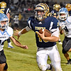 (Brad Davis/The Register-Herald) Shady Spring's Drew Clark eludes Lincoln County defenders as he breaks loose for a big gain on a quarterback keeper Friday night in Shady Spring.