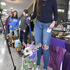 (Brad Davis/The Register-Herald) Ringo, dressed up as Buzz Lightyear, gets ready to walk before the judges with owner Taylor Craighead during the Humane Society of Raleigh County's Howl-o-Ween pet costume contest Saturday afternoon inside the Beckley Plaza Mall.