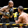 (Brad Davis/The Register-Herald) Beckley's Julian Green, left, takes on fellow Beckley resident Tyler Holmes in a light heavyweight matchup during the Original Toughman Contest Friday night at the Beckley-Raleigh County Convention Center. Green would win the fight.