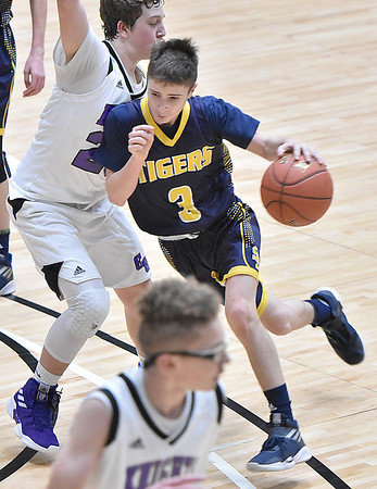 (Brad Davis/The Register-Herald) Shady Spring's Cole Chapman starts a drive as Eastern Greenbrier's Kaden Huffman defends during Big Atlantic Classic action Wednesday afternoon at the Beckley-Raleigh County Convention Center.