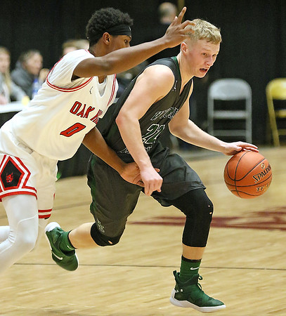 (Brad Davis/The Register-Herald) Wyoming East's drives as Oak Hill's Andrew Work defends during Big Atlantic Classic action Wednesday night at the Beckley-Raleigh County Convention Center.