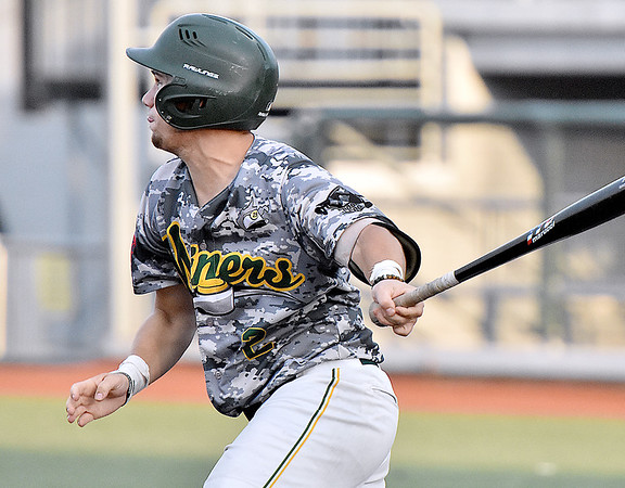 (Brad Davis/The Register-Herald) Miners batter Tynan Shahidi drives in teammate Noah Freimuth with a single off Chillicothe starting pitcher Taylor Perrett Friday night at Linda K. Epling Stadium.