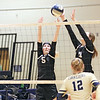 Greater Beckley Christian's Jenna Fisher (5) and Courtney Green (11)  block an attempt by Greenbrier West players during the Class A Region 3 Section 2 volleyball tournament at Greenbrier West Tuesday. (Jenny Harnish/The Register-Herald)