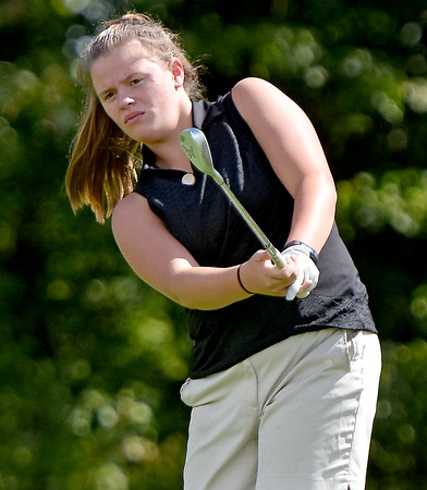(Brad Davis/The Register-Herald) Independence junior Ema Lilly chips onto a green during a practice round at Grandview Saturday afternoon.