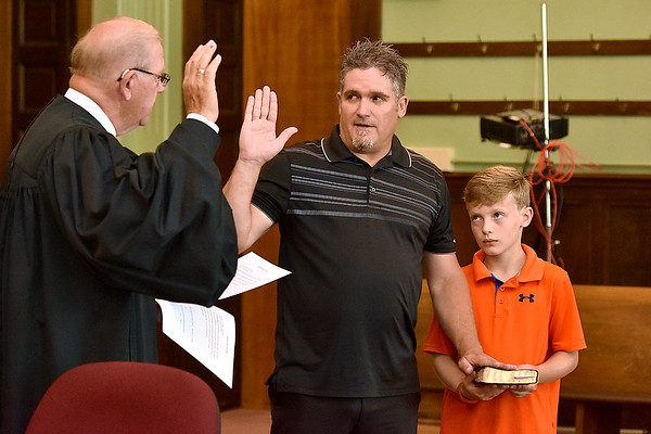 (Brad Davis/The Register-Herald) Brian Good is sworn in as Fayetteville Councilperson during the town's Swearing In Ceremony Friday evening inside the Fayette County Courthouse.