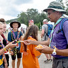 (Brad Davis/The Register-Herald) Scouts receive one of their last momentos of the event, an International Jamboree participation patch, during the last day of World Scout Jamboree activities Thursday afternoon at the Summit Bechtel Reserve.