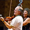 (Brad Davis/The Register-Herald) Fiddler Lewis Prichard, left, bassist Barbara Rosner and Beckley's own Long Point String Band perform during the Appalachian Jamboree August 22 at Woodrow Wilson High School.