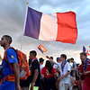 (Brad Davis/The Register-Herald) French scouts make their way into the stadium area at the World Scout Jamboree's Cultural Celebration Friday night at the Bechtel Summit Reserve.