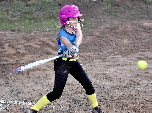 (Brad Davis/The Register-Herald) Beckley batter Baylor Hall takes a cut at Hedgesville pitcher Chloe Frankhouser's pitch during Little League 8-10 year-old Softball State Tournament action Wednesday night at Affinity park in Midway.