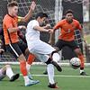 (Brad Davis/The Register-Herald) WVU Tech's Cristian Cubedo Aymerich turns to fire a shot on goal as Milligan's Roberto Fernandez Garrido, left, defends Saturday afternoon at the YMCA Paul Cline Memorial Sports Complex.