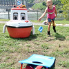 (Brad Davis/The Register-Herald) Six-year-old Jumping Branch resident Payton Mauro plays a cornhole game with Cory the Corps Boat, long-serving mascot for the Army Corps of Engineers, during the annual Safety On The Blue event Sunday afternoon at Hinton's Bellpoint Park. The event, put on every year by the Corps of Engineers along with the National Park Service, teaches kids of all ages how to stay safe on rivers, lakes and streams with games, a presentation on proper use of life jackets and how to determine their correct fit as well as a lifejacket giveaway.