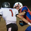 Liberty's Braden Howell prepares to bring down Cody Harrell of Midland Trail. Chad Foreman for the Register-Herald.