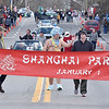 (Brad Davis/The Register-Herald) Matt Peltier, middle, dressed appropriately as Baby New Year, waves to the hundreds in attendance as most cheer, many laugh and a few cringe during the opening moments of Lewisburg's annual Shanghai Parade Wednesday afternoon.