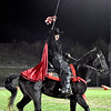 (Brad Davis/The Register-Herald) Senior Raider mascot Kiara Cline raises her sword for the home fans one last time before sticking it into the ground from atop her horse B.B. as Liberty takes the field for visiting Shady Spring Friday night in Glen Daniel.