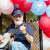 A parade participant plays banjo during the Labor Day Parade in Pineville on Monday. (Chris Jackson/The Register-Herald)