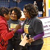 JoAnn Ross, sister of the late Reginald R. Rhodes, second from left and Angela Roach, daughter, watch Gloria Clark, pre-k teacher at Stratton Elementary School on South Kanawha Streret in Beckley, left, shed some tears after hearing she won the Reginald R. Rhodes Extraordinary Award. <br /> (Rick Barbero/The Register-Herald