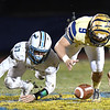 Haven Chapman, of Shady Spring, right, jumps on the ball after Tanner Cisco, of Mingo Central fumble the ball in the first half of the first round playoff game held at Shady Spring High School.<br /> (Rick Barbero/The Register-Herald)