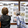 (Brad Davis/The Register-Herald) Lester area natives Lois Trump, right, and and Treva Wahl marvel at the displays packed with photos and history of the once booming region inside the newly opened Trap Hill History Museum Friday afternoon inside the former Lester Elementary School, now Lester's City Hall.
