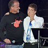 (Brad Davis/The Register-Herald) Emcee Tim Epling, left, comforts speaker Austin Cole after he delivered an emotional testimonial to his faith, one of many activities taking place during the first I Am Ingathering all-day event Saturday afternoon at Linda K. Epling Stadium.