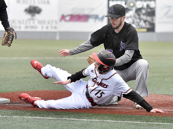 (Brad Davis/The Register-Herald) Greater Beckley Christian baserunner Braylon Arvon is tagged out by River View pitcher Garrett Auville after getting caught between 3rd base and home on a sharp, line-drive out to River View shortstop Brent Shupe Friday evening at Linda K. Epling Stadium.