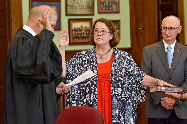 (Brad Davis/The Register-Herald) Sharon Cruikshank is sworn in as Fayetteville's 29th Mayor by Judge Paul M. Blake during the town's Swearing In Ceremony for herself and Town Council members Friday evening inside the Fayette County Courthouse. Cruikshank is Fayetteville's first female mayor.