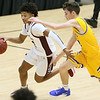 (Brad Davis/The Register-Herald) Woodrow Wilson's Bryant Jones rushes up the court as Logan's Noah Cook defends during Friday action at the Little General Battle for the Armory.