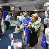 "Seniors looking over vendors information during, ""Senior Day Out"" held at Beckley-Raleigh County Convention Center. The event had, music bingo, vendors, door prizes, information about products and services for our senior community and was co-sponsored by, The Register-Herald and Raleigh County Commission on Aging."
