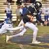(Brad Davis/The Register-Herald) Nicholas County ball carrier Justin Hill slips past Princeton defender Carter Meachum to break away for a long first half touchdown run Friday night in Summersville.