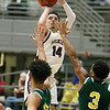 (Brad Davis/The Register-Herald) Woodrow Wilson's Bryce Radford pulls up for a three-point shot attempt as Huntington's Chianti Littlejohn, left, and Kris Brown defend Wednesday night at the Beckley-Raleigh County Convention Center.