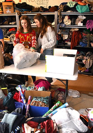 Shady Spring freshman, Riley Radford, left and Lacie Scott, sort through donated clothes for their Christmas Market that will take place in the Shady Spring High School cafetera, Friday, December, 20 from 3 p.m. to 6 p.m.<br /> (Rick Barbero/The Register-Herald)
