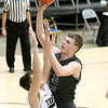 (Brad Davis/The Register-Herald) Wyoming East's Jacob Bishop drives and scores as Shady Spring's Erick Bevil defends on Big Atlantic Classic Championship Saturday at the Beckley-Raleigh County Convention Center.