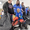 (Brad Davis/The Register-Herald) Young volunteer Mason Blankenship, 4, makes sure a toy four-wheeler picked out by shopper Barbie Belcher, left, works good during the Wyoming County Toy Fund event Sunday morning at Wyoming East High School.