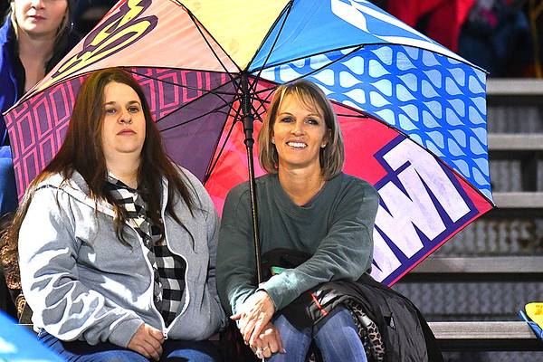 Shady Spring fans covered up from the rain during game against Braxton Co. at Shady Spring High School.<br /> (Rick Barbero/The Register-Herald)