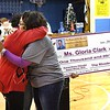 Angela Roach, daughter if the late Reginald R. Rhodes, right, hugs Gloria Clark, pre-k teacher at Stratton Elementary School on South Kanawha Streret in Beckley, left, after announcing she won the Reginald R. Rhodes Extraordinary Award. <br /> (Rick Barbero/The Register-Herald