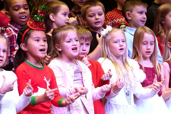 """Second graders at Maxwell Hill Elementary School, sang """"We Wish You a Merry Christmas and All I Want for Christmas is Mt Two Front Teeth"""" during their annual Christmas performance held at Woodrow Wilson auditorium Monday morning. Music teacher Vickie Pachuta directed each class from pre-k to 5th grade to sing two christmas songs each along with sing alongs from the audience.<br /> (Rick Barbero/The Registewr-Herald)"""