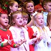 "Second graders at Maxwell Hill Elementary School, sang ""We Wish You a Merry Christmas and All I Want for Christmas is Mt Two Front Teeth"" during their annual Christmas performance held at Woodrow Wilson auditorium Monday morning. Music teacher Vickie Pachuta directed each class from pre-k to 5th grade to sing two christmas songs each along with sing alongs from the audience.<br /> (Rick Barbero/The Registewr-Herald)"