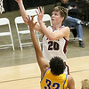 (Brad Davis/The Register-Herald) Woodrow Wilson's Ayden Ince drives and scores as Logan's David Early defends during Friday action at the Little General Battle for the Armory.