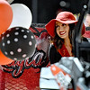 (Brad Davis/The Register-Herald) Attendants roll in on personalized floats to their waiting escorts as homecoming festivities get underway during halftime Friday night in Glen Daniel.