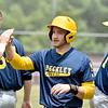 (Brad Davis/The Register-Herald) Beckley Post 32's Tanner Buchanan gets kudos from his teammates after scoring against Parkersburg Post 15 Saturday at Woodrow Wilson High School.