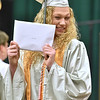 (Brad Davis/The Register-Herald) Graduating Wyoming East senior Emily Saunders poses for friends and family after collecting her diploma Friday night in New Richmond.