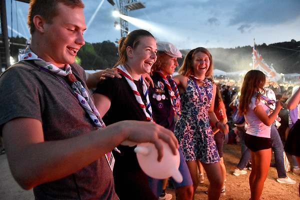 (Brad Davis/The Register-Herald) Scouts from the Czech Republic dance together during the World Scout Jamboree's Cultural Celebration Friday night at the Bechtel Summit Reserve.