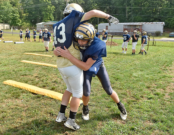(Brad Davis/The Register-Herald) Shady Spring players work through quick pop and release drills during Tigers practice Friday evening in Shady Spring.